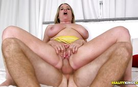 Appetizing Maggie Green works her throat on a thick boner