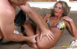 Cheerful brown-haired girlfriend Mandi Moretti blows and rides a thick ramrod