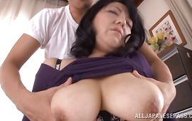 Lovely mature hottie Emiko Ejima with big tits gets caressed and spoiled by a crazy lover