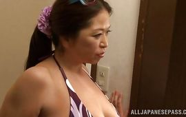 Amazing girlie Natsuko Kayama with round tits hungrily slobbers on a hard mamba