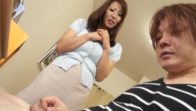 Beautiful Rika Fujishita with big tits is sucking buddy's stick and getting ready to get fucked from the back