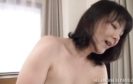 Perverted hottie Hitomi Enjou is gently sucking one of the biggest slim jims she has ever seen