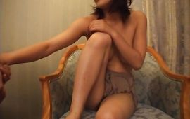 Frisky busty mature girl puts a meat in her sexy mouth