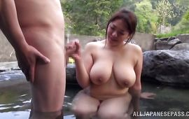 Hot milf is kneeling in front of dude and gently sucking his hard pipe