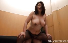 Sassy Natsuko Kayama with huge tits receives an intense from behind plowing