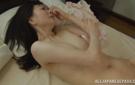 Foxy Tomoko Yanagi puts a dangler in her moist and hot mouth