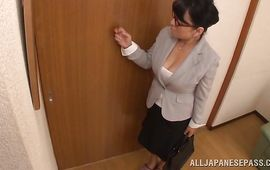 Turned on mature playgirl Emiko Ejima with round tits gets down on knees and gives a pretty oral-job