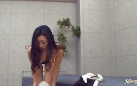 Excited Aiko Kanamori is eagerly rubbing her putz while getting ready for having sex with pal