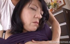 Attractive bosomed mature Emiko Ejima is having her 1st sex in front of the camera