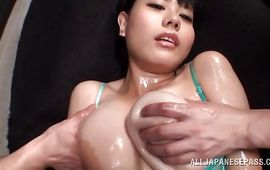 Amazing busty Sakura Mano shows her stuff to brawny fellow